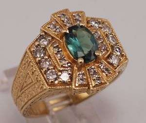 14 karat, solid yellow gold alexandrite/diamond ring